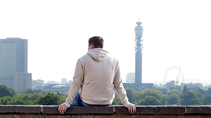 Man looking at BT Tower with 4G ,3G and 2G BT Mobile coverage