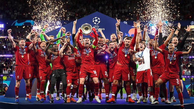 Liverpool captain Jordan Henderson lifts the Champions League aloft