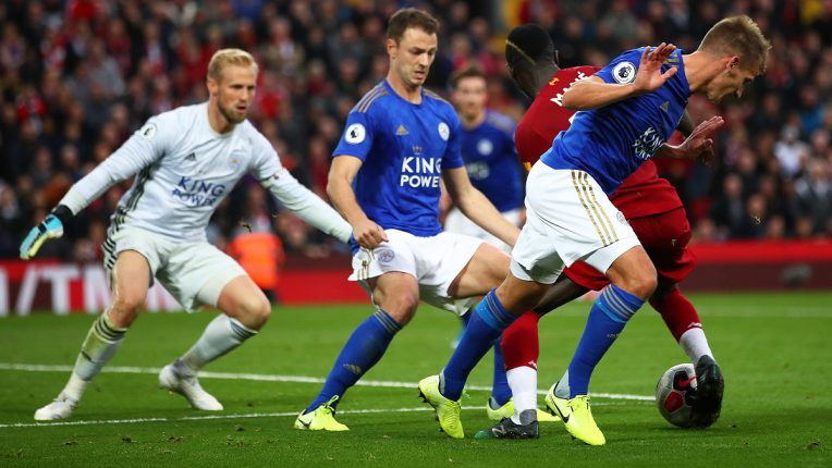 Leicester players try to tackle Sadio Mane at Anfield