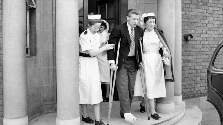 Roy Dwight leaves hospital on crutches after the Nottingham Forest forward's injury in the 1959 FA Cup final