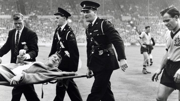 Blackburn Rovers' Dave Whelan is carried off on a stretcher during the 1960 FA Cup final against Wolves