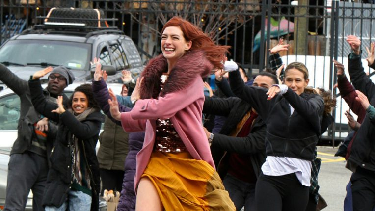 Anne Hathaway filming a scene on the street for Modern Love