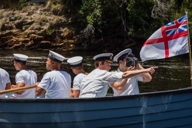 Dan Ings and Matt Smith on a boat during filming of The Crown