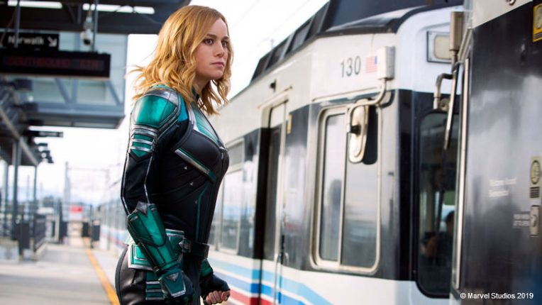 Brie Larson boards a train as Captain Marvel