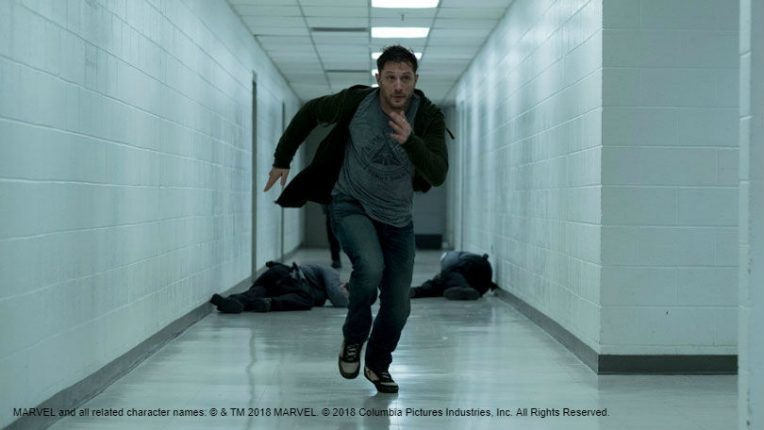 Tom Hardy running in the film Venom