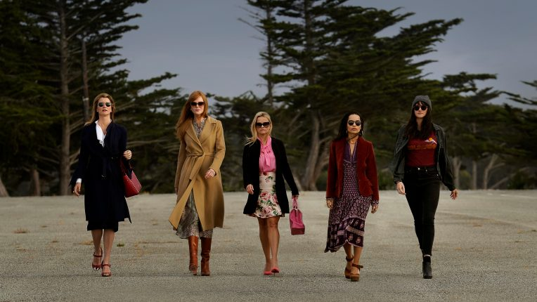 The cast of Big Little Lies walking across the beach