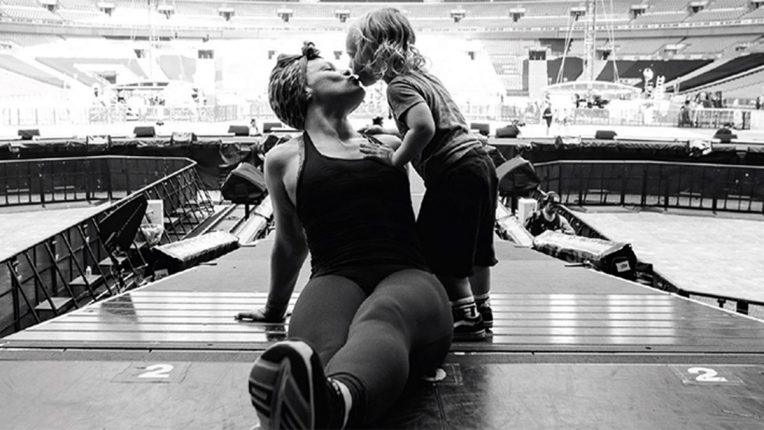 P!NK on stage with her child