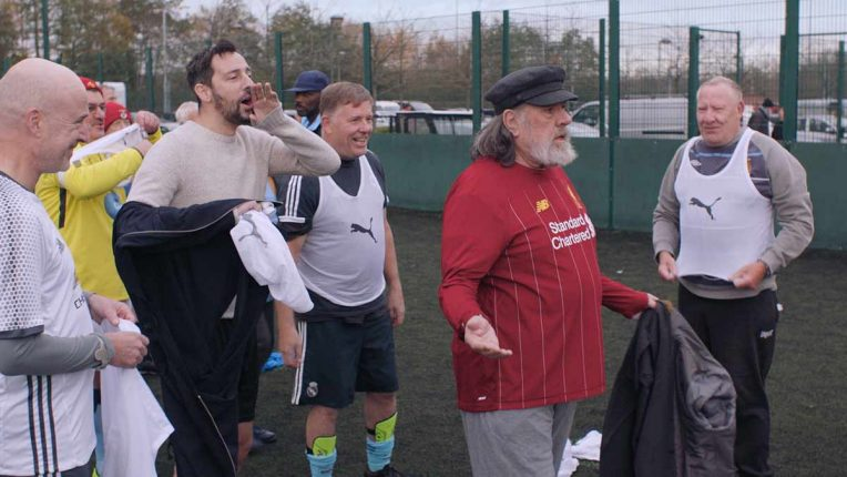 Ralf Little and Ricky Tomlinson playing football