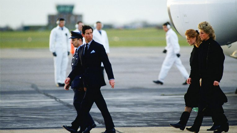 The royal party arrive back at RAF Northolt two days after the tragedy