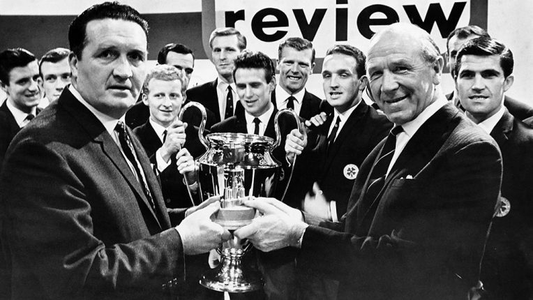 Jock Stein (left) receives the BBC Sports Review Team of the Year Award from Matt Busby