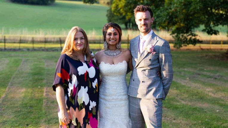 Sarah Haywood with a happy couple on their wedding day in The Wedding Fixer