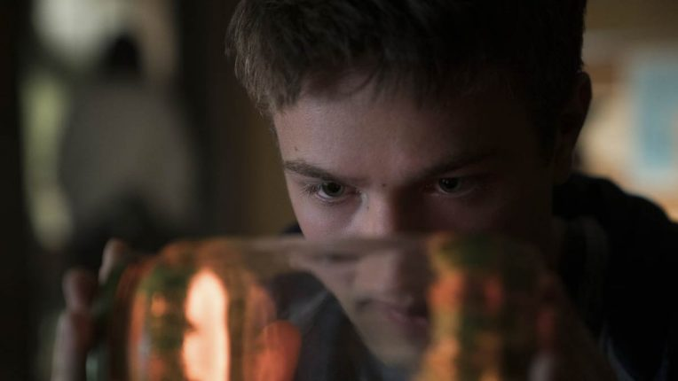 Connor Jessup's Tyler Locke  looks into a jar filled with a memory