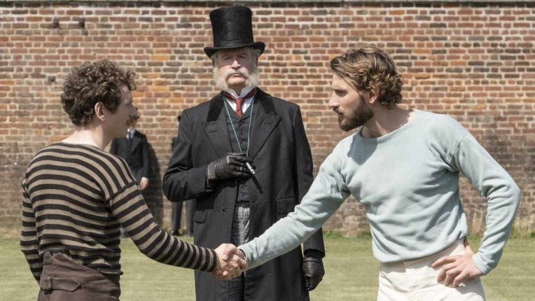 Arthur Kinnaird, played by Ed Holcroft, shakes an opposition players hand before a match
