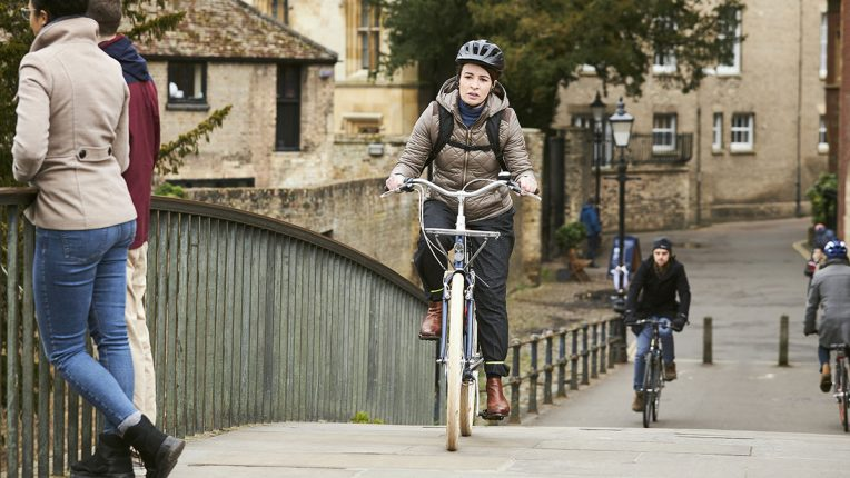 Liz Baildon cycles across Garret Hostel Lane Bridge