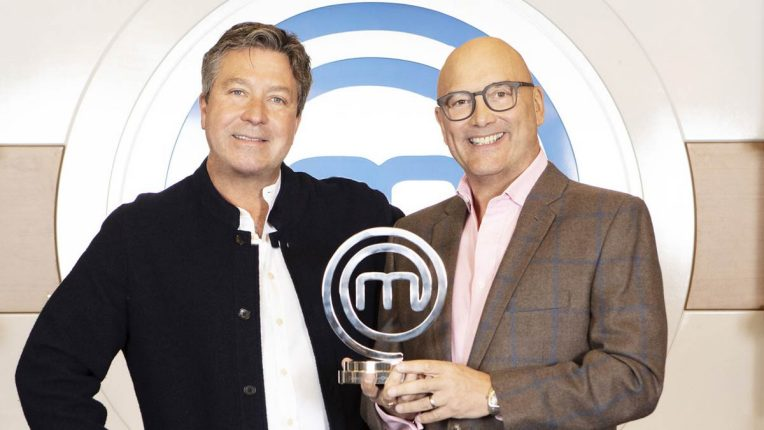 John Torode and Gregg Wallace holding the MasterChef trophy
