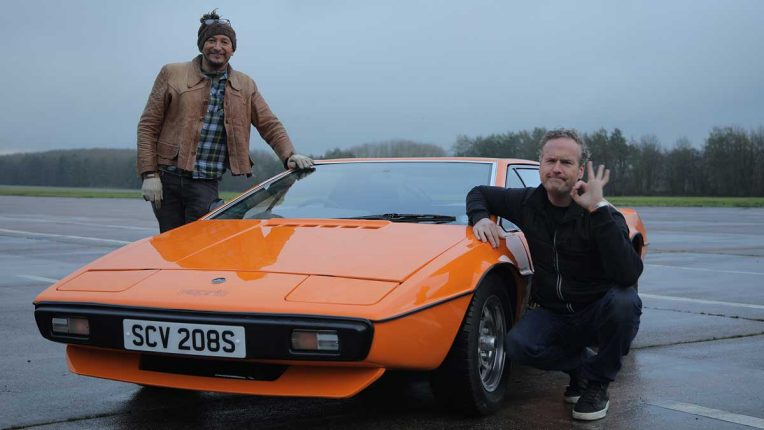Fuzz and Tim pose beside a pristine Lotus Esprit S1