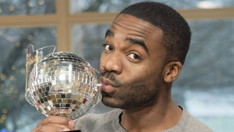 Ore Oduba holding Strictly trophy