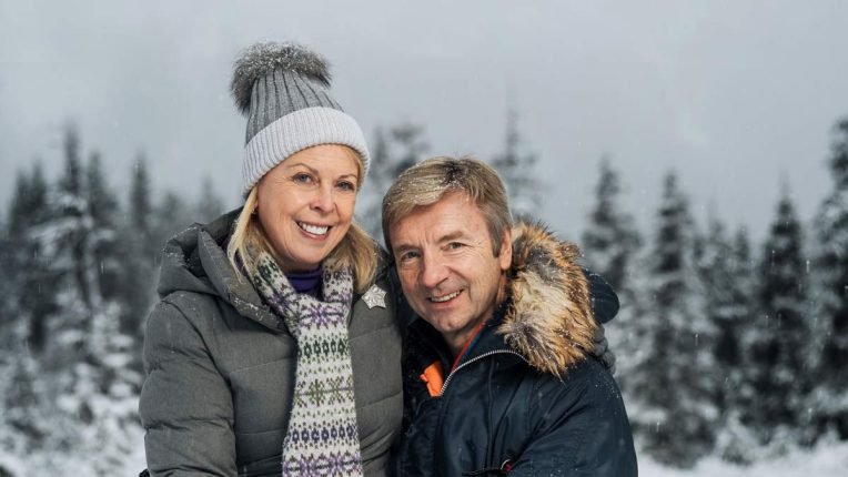 Torvill and Dean pose in the snow