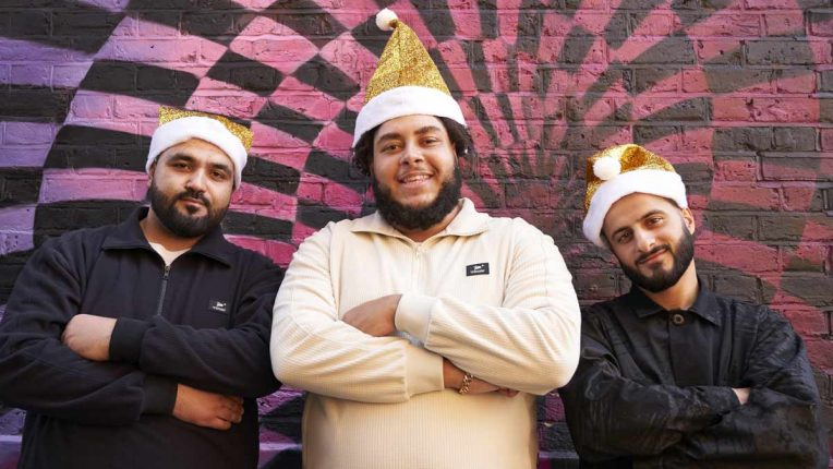 Big Zuu and his crew pose in Christmas hats